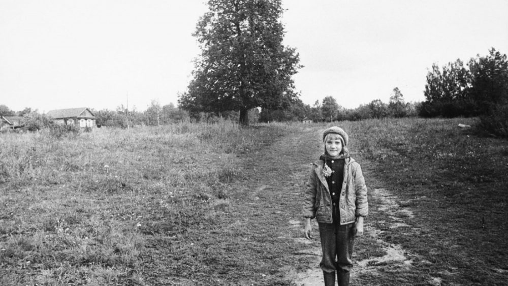 © Uģis Niedre. 9 years old Tanja Rozenberga on the countryside road, 1982