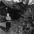 © Uģis Niedre. Lidija Ivanova (maiden name Liepa, 70 years old) near her house. 17.09.1982