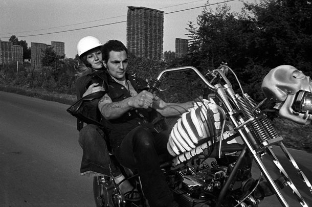 Yan Morvan. Suburbs of Paris, 1977. From Bikers. A gang leader Tesos is driving his motorbike.